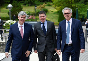 Portuguese Finance Minister and Eurogroup President Mario Centeno (L) and Luxembourg's Finance Minister Pierre Gramegna (R) welcome Ireland's Public Expenditure and Reform Minister Paschal Donohoe during a Eurogroup meeting in Luxembourg on June 21, 2018. (Photo by JOHN THYS / AFP)        (Photo credit should read JOHN THYS/AFP/Getty Images)