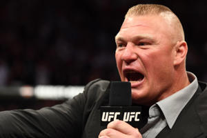 Brock Lesnar confronts Daniel Cormier in their UFC heavyweight championship fight during the UFC 226 event inside T-Mobile Arena