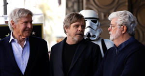 Actor Mark Hamill (C) talks with actor Harrison Ford (L) and filmmaker George Lucas after unveiling his star on the Hollywood Walk of Fame in Los Angeles, California, U.S., March 8, 2018. REUTERS/Mario Anzuoni