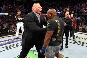Brock Lesnar confronts Daniel Cormier after his UFC heavyweight championship fight during the UFC 226 event inside T-Mobile Arena