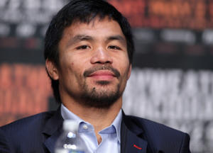WBO welterweight champion Manny Pacquiao listens during a  news conference at the KA Theatre at MGM Grand Hotel & Casino on April 29, 2015 in Las Vegas, Nevada. Pacquiao will face WBC/WBA welterweight champion Floyd Mayweather Jr. in a unification bout on May 2, 2015 in Las Vegas.