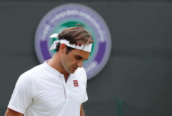 Slide 1 of 34: Tennis - Wimbledon - All England Lawn Tennis and Croquet Club, London, Britain - July 11, 2018. Switzerland's Roger Federer reacts during his quarter final match against South Africa's Kevin Anderson.  REUTERS/Andrew Boyers