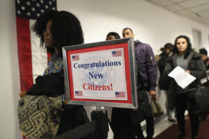 Immigrants wait in line to become US citizens at a naturalization ceremony on February 2, 2018 in New York City. U.S. Citizenship and Immigration Services (USCIS) swore in 128 immigrants from 42 different countries during the ceremony at the downtown Manhattan Federal Building.