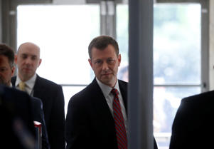 """FBI Deputy Assistant Director Peter Strzok passes through security as he arrives to testify before a House Committees on the Judiciary and Oversight & Government Reform joint hearing on """"Oversight of FBI and DOJ Actions Surrounding the 2016 Election""""in Washington, U.S., July 12, 2018."""