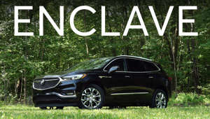 a car parked in the grass: 2018 Buick Enclave Road Test