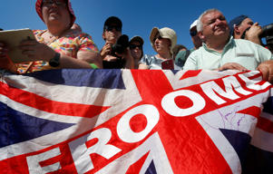 Supporters of Britain's Chris Froome wait for the start of the fourth stage of the Tour de France cycling race over 195 kilometers (121 miles) with start in La Baule and finish in Sarzeau, France, Tuesday, July 10, 2018.