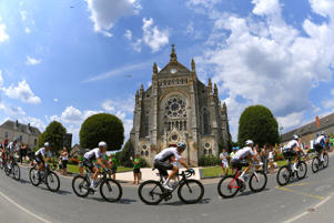 Christopher Froome of Great Britain and Team Sky / Michal Kwiatkowski of Poland and Team Sky / Geraint Thomas of Great Britain and Team Sky / Vay City / Landscape / Peloton / Church / Fans / Public / during the 105th Tour de France 2018, Stage 4 a 195km stage from La Baule to Sarzeau / TDF / on July 10, 2018 in Sarzeau, France.