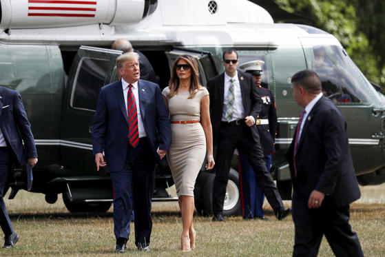 Slide 1 of 19: Donald Trump and Melania Trump arrive at Winfield House, residence of the U.S. ambassador to the United Kingdom, in London, England, July 12.
