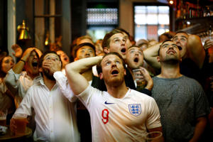 Soccer Football - World Cup - England fans watch Croatia v England - Trafalgar Square, London, Britain - July 11, 2018   England fans react as they watch the match   REUTERS/Henry Nicholls     TPX IMAGES OF THE DAY