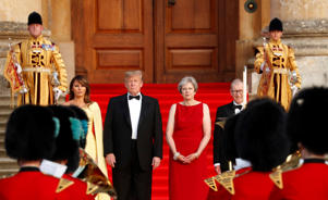 British Prime Minister Theresa May and her husband Philip stand together with U.S. President Donald Trump and first Lady Melania Trump at the entrance to Blenheim Palace, where they are attending a dinner with specially invited guests and business leaders, near Oxford, Britain, July 12, 2018. REUTERS/Kevin Lamarque