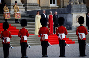 From left, first lady Melania Trump, President Donald Trump, British Prime Minister Theresa May, and her husband Philip May, watch the arrival ceremony at Blenheim Palace, Oxfordshire, west of London, Thursday, July 12, 2018. (AP Photo/Pablo Martinez Monsivais)