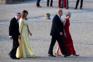 U.S. President Donald Trump and First Lady Melania Trump are met by British Prime Minister Theresa May and her husband Philip at Blenheim Palace, where they are attending a dinner with other specially invited guests and business leaders, near Oxford, Britain, July 12, 2018. Will Oliver/Pool via REUTERS