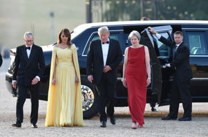 U.S. President Donald Trump and First Lady Melania Trump are met by British Prime Minister Theresa May and her husband Philip at Blenheim Palace, where they are attending a dinner with other specially invited guests and business leaders, near Oxford, Britain, July 12, 2018. Geoff Pugh/Pool via REUTERS