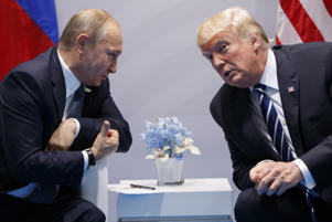 FILE In this file photo taken on Friday, July 7, 2017, U.S. President Donald Trump meets with Russian President Vladimir Putin at the G-20 Summit in Hamburg, Germany. If Vladimir Putin fulfills the goals he's set for his new six-year term as president, Russia in 2024 will be far advanced in new technologies, many of its notoriously poor roads will be improved, and its people will be living significantly longer. But there's wide doubt about how much of that he'll achieve, if any of it. (AP Photo/Evan Vucci, File)
