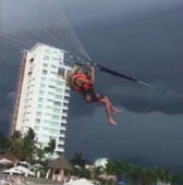 Woman hurt in parasailing crash