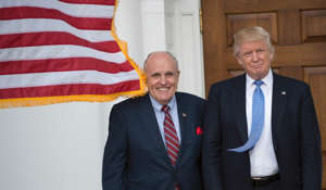 Then-President-elect Donald Trump meets with Rudy Giuliani at the Trump National Golf Club in Bedminster, New Jersey, on November 20, 2016.