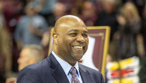 Leonard Hamilton wearing a suit and tie standing in front of a crowd: Video: FSU basketball cuts down the nets after winning ACC regular season title