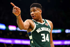 Giannis Antetokounmpo holding a ball: If you are an NBA player, there is a good chance you are a known name. You may very well be a star and even one who surpasses the world of sports fandom. Everybody knows Michael Jordan, right? Some guys are known by only one name. Shaq. Kobe. LeBron. Then there are the famous nicknames and the maybe not-as-famous nicknames that are still fun. Who doesn't like a good nickname? We certainly do, and so do NBA fans. Here are our 25 favorite NBA nicknames.