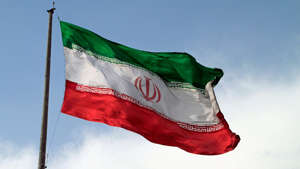 a close up of a flag: Iran: South Korea releasing $1B frozen by US sanctions