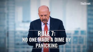 Jim Cramer holding a sign