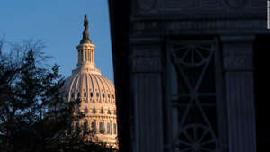 a clock tower in front of a building: The Capitol dome is seen early Wednesday morning before Amb. William Taylor And Deputy Assistant Secretary Of State George Kent testify at the first public impeachment hearing before the House Intelligence Committee on Capitol Hill November 13, 2019 in Washington, DC.