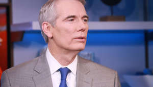 Rob Portman wearing a suit and tie