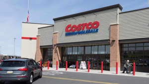 a car parked in front of a building: Costco only accepts Visa credit cards in its stores, making the Costco Anywhere Visa card a solid choice.