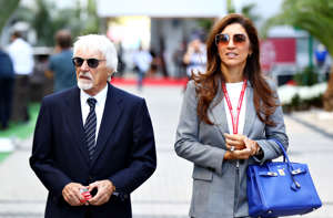SOCHI, RUSSIA - SEPTEMBER 29: Bernie Ecclestone, Chairman Emeritus of the Formula One Group, and his wife Fabiana walk in the Paddock before the F1 Grand Prix of Russia at Sochi Autodrom on September 29, 2019 in Sochi, Russia. (Photo by Mark Thompson/Getty Images)