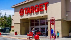 a group of people standing in front of a store: Almost anything you buy at Target will get a 5% discount with the Target REDcard.