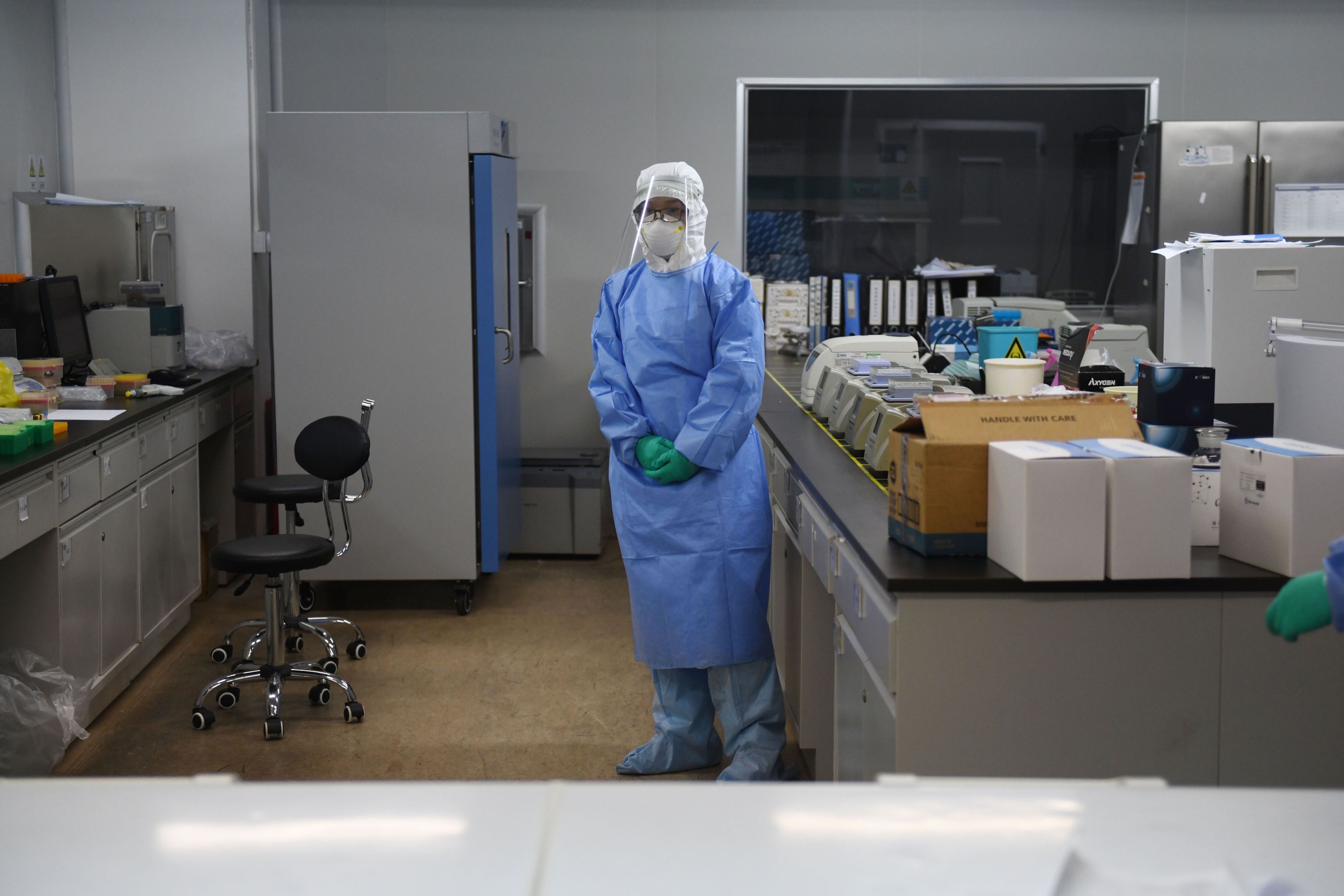 10 2020 shows a technician in a sample mixing lab at Capital Bio Technology a Beijing-based company which makes medical test kits in Beijing.- The company which first detected the novel coronavirus in samples from Wuhan is