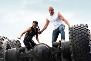 Vin Diesel sitting on a tractor: fast and furious 9 , Vin Diesel, charlize theron