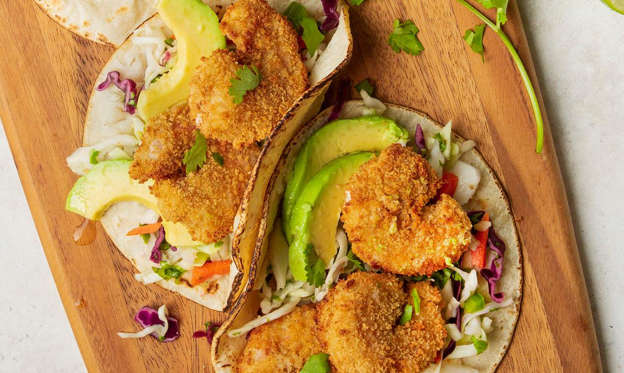 Slide 1 of 12: These healthy popcorn shrimp tacos combine classic flavors in a new way! It's one of my family's favorites. To make them low-carb, use lettuce instead of tortillas. —Julie Peterson, Crofton, Maryland Get Recipe