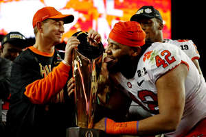 a man wearing a red hat: 2018: Clemson Tigers
