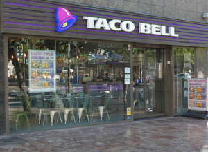 a sign above a store: taco bell storefront
