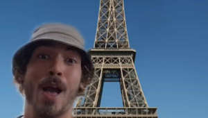 a person standing in front of a tower