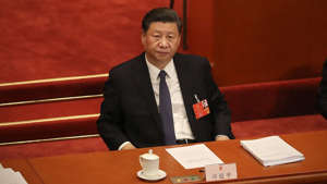 Xi Jinping in a suit and tie sitting at a table: Trump, GOP go all-in on anti-China strategy