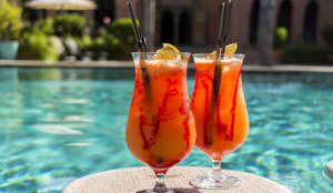 Fruity cocktails floating on swimming pool