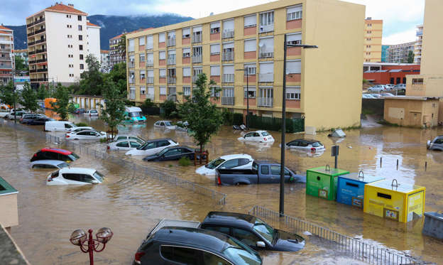 Slide 1 of 50: Submerged cars remain in the middle of a flooded area after heavy rainfalls in Ajaccio, Corsica island, France, 11 June 2020. Corsica is under orange alert due to severe weather.