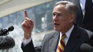Greg Abbott wearing a suit and tie: Texas bar owners sue to overturn closures