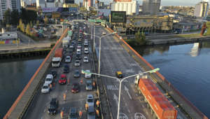 Commuters sit in traffic on the Pueyrredon bridge as police stop them to check identification and permission to circulate on the first day of a return to stricter restrictions to curb the spread of COVID-19, before allowing them to enter Buenos Aires, Argentina, Wednesday, July 1, 2020. After a brief relaxation of the lockdown to contain the spread of COVID-19, authorities returned to tighter restrictions in the capital after seeing a spike in cases. (AP Photo/Gustavo Garello): Commuters sit in traffic on the Pueyrredon bridge as police stop them to check identification and permission to circulate on the first day of a return to stricter restrictions to curb the spread of COVID-19, before allowing them to enter Buenos Aires, Argentina, Wednesday, July 1, 2020. After a brief relaxation of the lockdown to contain the spread of COVID-19, authorities returned to tighter restrictions in the capital after seeing a spike in cases. ()