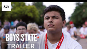 a close up of a man holding a sign: SUBSCRIBE: http://bit.ly/A24subscribe