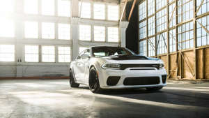 a car parked in front of a window: 2021 Dodge Charger SRT Hellcat Redeye
