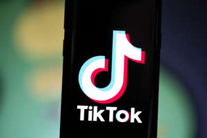 a close up of a sign: TikTok, popular among teens, lets users add music and effects to short videos. Angela Lang/CNET