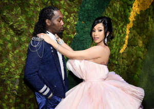 a person in a wedding dress: Cardi Bhada babyin 2018 with Migos rapper Offset. Though young, the star knows exactly what her stance on love is.