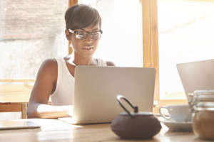 a woman sitting at a table: You can avoid costly retirement mistakes by picking the right retirement plan for yourself and your business.As a self-employed freelance writer, I spent hours researching and learning about different self-employed retirement plans. When you're self-employed or run a small business, these retirement savings plans are not an automatic benefit like an employer-sponsored 401(k) or pension plan that many employees receive as part of their job.Thankfully, there are a number of self-employed retirement plan options, but each comes with its own benefits and limitations. Ultimately, I settled on a solo 401(k) for my business, but that doesn't mean it's the best fit for everyone.Here's everything you need to know about self-employed retirement plans and how to choose the right plan for you. We'll talk through the plans one by one, and then give you some tips on how to open the retirement account of your choosing, so you can start putting aside some of your self-employment income to create a successful retirement scenario for yourself.  Related: 7 brilliant moves to thrive in an uncertain economy
