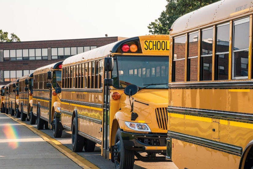 a school bus that is parked on the side of a road: Teachers in at least five states have died with coronavirus since fall semester started