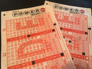 a close up of text on a white background: Tickets shown for the Powerball lottery in Texas during June 2019.