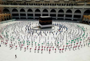 Hundreds of Muslim pilgrims circle the Kaaba, the cubic building at the Grand Mosque, as they observe social distancing to protect themselves against the coronavirus, in the Muslim holy city of Mecca, Saudi Arabia, Wednesday, July 29, 2020 During the first rites of hajj, Muslims circle the Kaaba counter-clockwise seven times while reciting supplications to God, then walk between two hills where Ibrahim's wife, Hagar, is believed to have run as she searched for water for her dying son before God brought forth a well that runs to this day.