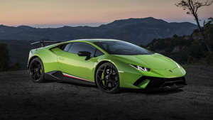 a green car parked on the side of a mountain: 2017 Lamborghini Huracan Performante: First Drive