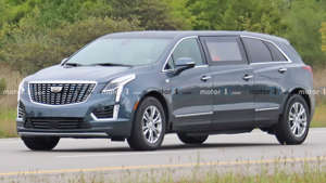 a car parked on the side of a road: Cadillac XT5 Limousine Spy Photos